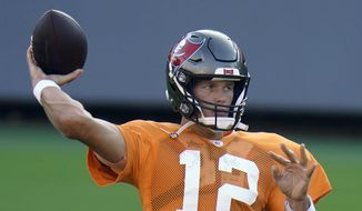 Tampa Bay Buccaneers quarterback Tom Brady (12) throws a pass during an NFL football training camp practice Friday, Aug. 28, 2020, in Tampa, Fla. (AP Photo/Chris O'Meara)  **FILE**