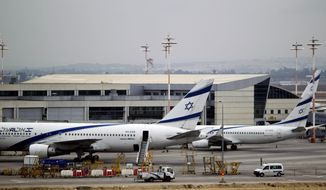 FILE - In this April 21, 2013, file photo, Israeli El Al planes are parked at Ben Gurion airport near Tel Aviv, Israel. Israel has listed an El Al flight taking off Monday, Aug. 31, 2020, for Abu Dhabi, which would be Israel's first commercial passenger flight to the United Arab Emirates after the two countries agreed to a U.S.-brokered deal to normalize relations. (AP Photo/Ariel Schalit, File)