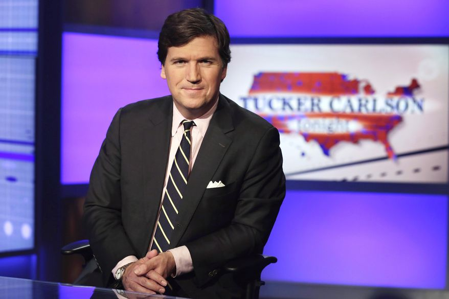 """In this March 2, 2017, file photo Tucker Carlson, host of """"Tucker Carlson Tonight,"""" poses for photos in a Fox News Channel studio, in New York. (AP Photo/Richard Drew, File)"""