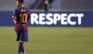 Barcelona's Lionel Messi leaves the pitch after the the Champions League quarterfinal soccer match between Barcelona and Bayern Munich in Lisbon, Portugal, Friday, Aug. 14, 2020. Bayern won the match 8-2. (Rafael Marchante/Pool via AP)
