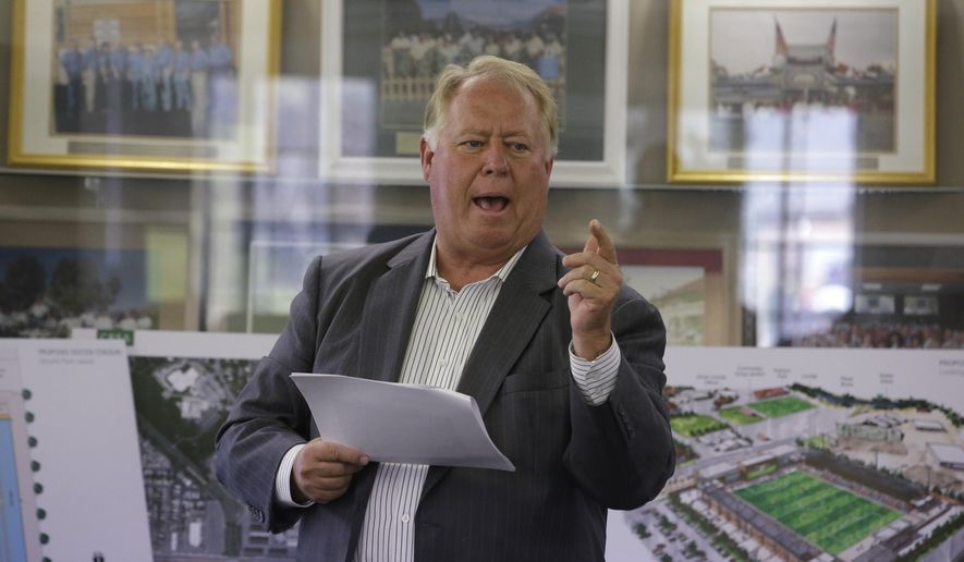 FILE - Real Salt Lake owner Dell Loy Hansen presents his vision for a new minor league soccer stadium on Sept. 10, 2014, in Salt Lake City. Hansen has come under criticism for comments he made on a radio show after RSL players decided not to take the field for a match to protest racial injustice. (AP Photo/Rick Bowmer, File)