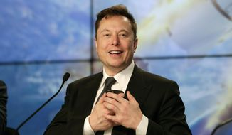 In this Sunday, Jan. 19, 2020, file photo, Elon Musk founder, CEO and chief engineer/designer of SpaceX, speaks during a news conference after a Falcon 9 SpaceX rocket test flight to demonstrate the capsule's emergency escape system at the Kennedy Space Center in Cape Canaveral, Fla. (AP Photo/John Raoux, File)
