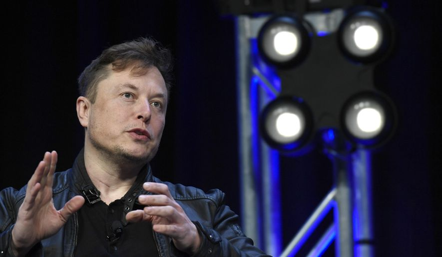 Tesla and SpaceX Chief Executive Officer Elon Musk speaks at the SATELLITE Conference and Exhibition in Washington, March 9, 2020. (AP Photo/Susan Walsh)  ** FILE **