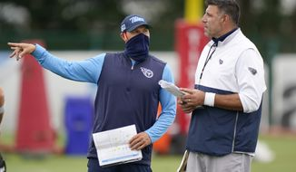 Tennessee Titans head coach Mike Vrabel, right, talks with special teams coach Craig Aukerman during NFL football training camp Friday, Aug. 28, 2020, in Nashville, Tenn. (AP Photo/Mark Humphrey, Pool)
