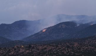 Smoke drifts from fires Thursday, Aug. 27, 2020, in Pecos National Forest near Santa Fe, N.M. As of Thursday the fire, started by a lightning strike, had not posed a risk to life or property. But the smoke that wafts across the county each day is a reminder of growing fire risk along a forest edge that is drier and more populated each decade. (AP Photo/Cedar Attanasio)