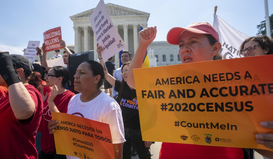 In this June 27, 2019, photo, demonstrators gather at the Supreme Court as the justices finish the term with key decisions on gerrymandering and a census case involving an attempt by the Trump administration to ask everyone about their citizenship status in the 2020 census, on Capitol Hill in Washington. (AP Photo/J. Scott Applewhite) **FILE**