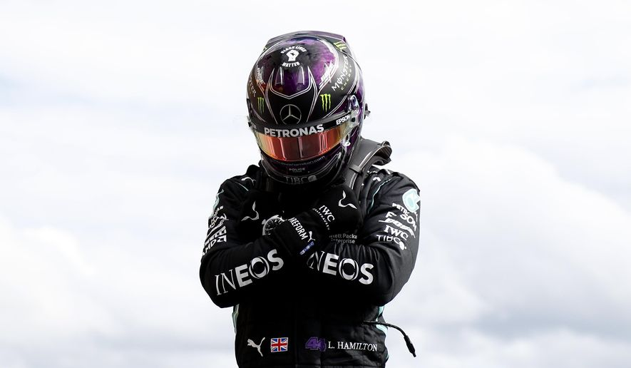 Mercedes driver Lewis Hamilton of Britain reacts after the qualifying session prior to the Formula One Grand Prix at the Spa-Francorchamps racetrack in Spa, Belgium Saturday, Aug. 29, 2020. Hamilton will start in pole position for race on Sunday. (Francois Lenoir, Pool via AP)