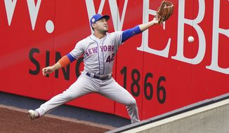 New York Mets right fielder Michael Conforto misses a triple hit by New York Yankees' DJ LeMahieu off starting pitcher Robert Gsellman in the third inning of a baseball game, Saturday, Aug. 29, 2020, in New York. (AP Photo/John Minchillo)