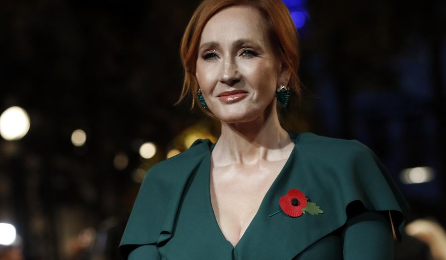 """In this Thursday, Nov. 8, 2018 file photo, writer J.K. Rowling poses for the media at the world premiere of the film """"Fantastic Beasts: The Crimes of Grindelwald"""" in Paris. (AP Photo/Christophe Ena, file)"""
