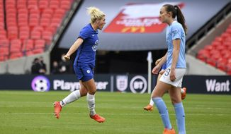 Chelsea's Millie Bright, left, celebrates after scoring the opening goal during the English FA Women's Community Shield soccer match between Chelsea and Manchester City at Wembley stadium in London, Saturday, Aug. 29, 2020. (Justin Tallis/Pool via AP)