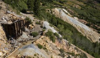 An old structure and piles of tailings, the waste product left over from mining operations, are seen at the former Yankee Mine in Mary Ellen Gulch, Utah, a basin near the top of American Fork Canyon, on Saturday, Aug. 15, 2020. (Spenser Heaps/The Deseret News via AP)