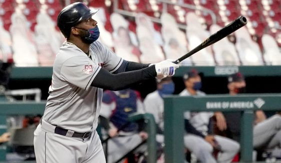 Cleveland Indians' Franmil Reyes watches his three-run home run during the first inning of a baseball game against the St. Louis Cardinals Friday, Aug. 28, 2020, in St. Louis. (AP Photo/Jeff Roberson)