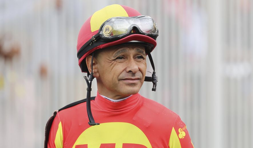 FILE- In this May 3, 2019, file photo, jockey Mike Smith looks on before a horse race at Churchill Downs in Louisville, Ky. Jockeys competing in the rescheduled 146th Kentucky Derby have to arrive five days ahead and then quarantine upon returning to their home tracks, just one of many changes forced by the coronavirus pandemic. (AP Photo/Gregory Payan, File)