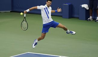 Novak Djokovic, of Serbia, returns a shot to Milos Raonic, of Canada, during the finals of the Western & Southern Open tennis tournament Saturday, Aug. 29, 2020, in New York. (AP Photo/Frank Franklin II)