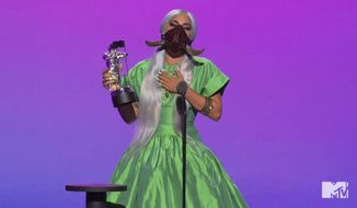 """In this video grab issued Sunday, Aug. 30, 2020, by MTV, Lady Gaga accepts the award for song of the year for """"Rain On Me"""" during the MTV Video Music Awards. (MTV via AP)"""