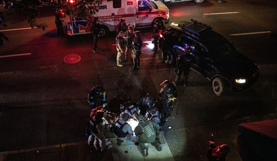 A man was fatally shot Saturday in Portland, Oregon, after counterdemonstrators downtown confronted a caravan of about 600 vehicles. Members of the right-wing Patriot Prayer group said the man was one of theirs, and they blamed Black Lives Matter protesters and Antifa for his death. (Associated Press)