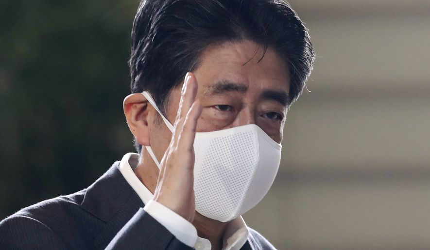 Japan's Prime Minister Shinzo Abe wearing a face mask, arrives at Prime Minister's office in Tokyo, Monday, Aug. 31, 2020.  Japan's longest-serving prime minister, Abe, said Friday, he is stepping down because a chronic health problem has resurfaced.(AP Photo/Koji Sasahara)