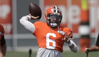 Cleveland Browns quarterback Baker Mayfield throws during practice at the NFL football team's training camp facility, Thursday, Aug. 27, 2020, in Berea, Ohio. (AP Photo/Tony Dejak)