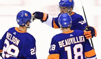 New York Islanders center Brock Nelson (29) celebrates his goal with teammates Anthony Beauvillier (18) and Josh Bailey (12) during the second period of an NHL Stanley Cup Eastern Conference playoff hockey game, Sunday, Aug. 30, 2020 in Toronto. (Frank Gunn/The Canadian Press via AP)