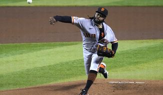 San Francisco Giants pitcher Johnny Cueto throws against the Arizona Diamondbacks in the first inning during a baseball game, Sunday, Aug 30, 2020, in Phoenix. (AP Photo/Rick Scuteri)
