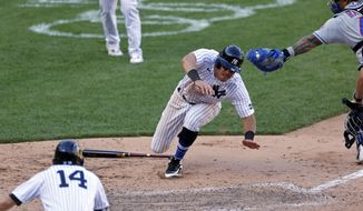 New York Yankees' Mike Tauchman scores the game winning run under a tag attempt by New York Mets catcher Wilson Ramos during the eighth inning of the first baseball game of a doubleheader, Sunday, Aug. 30, 2020, in New York. The Yankees won 8-7. (AP Photo/Adam Hunger)