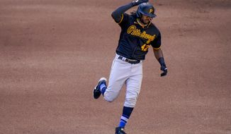 Pittsburgh Pirates' Josh Bell rounds the bases after hitting a two-run home run during the fourth inning of a baseball game against the Milwaukee Brewers Sunday, Aug. 30, 2020, in Milwaukee. (AP Photo/Morry Gash)