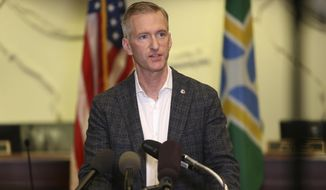 Portland Mayor Ted Wheeler calls for an end to violence in the city during a news conference Sunday, Aug. 30, 2020, a day after a demonstrator was shot and killed in downtown Portland on Saturday. (Sean Meagher/The Oregonian via AP)
