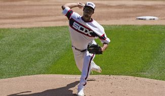 Chicago White Sox starting pitcher Dane Dunning throws the ball against the Kansas City Royals during the first inning of a baseball game in Chicago, Sunday, Aug. 30, 2020. (AP Photo/Nam Y. Huh)