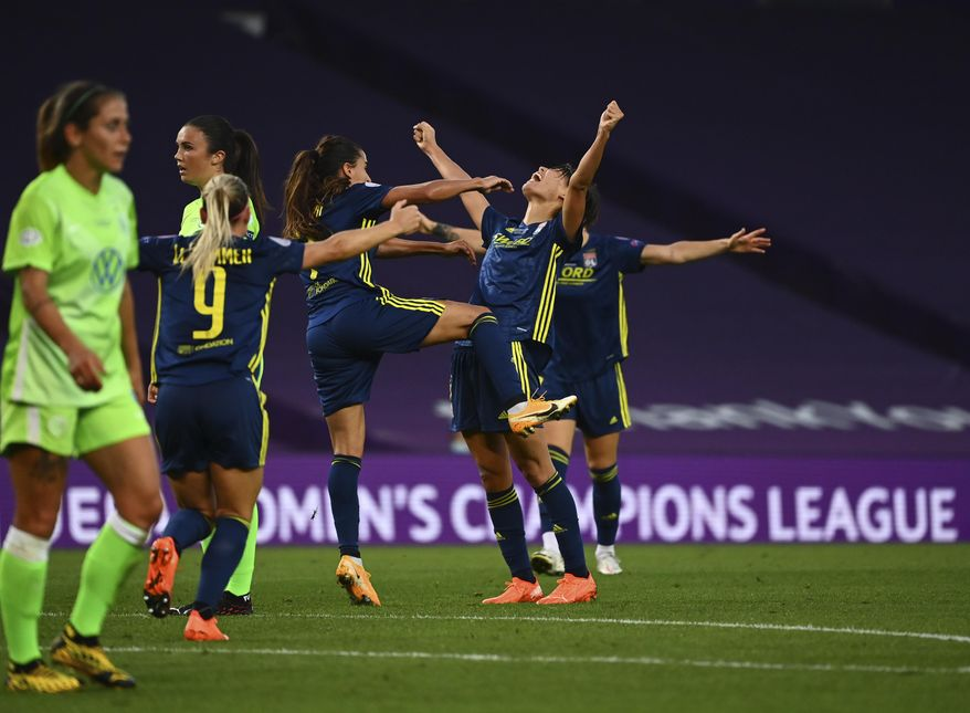 Lyon's Saki Kumagai celebrates with teammates after scoring her side's second goal during the Women's Champions League final soccer match between Wolfsburg and Lyon at the Anoeta stadium in San Sebastian, Spain, Sunday, Aug. 30, 2020. (Gabriel Buoys/Pool via AP)