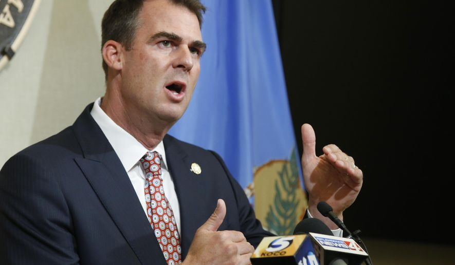 FILE - In this Thursday, July 9, 2020 file photo, Oklahoma Gov. Kevin Stitt speaks during a news conference in Oklahoma City. Oklahoma Gov. Kevin Stitt recommended three Native Americans and two Black Oklahomans as national heroes who should be considered for inclusion in a new National Garden of American Heroes. (AP Photo/Sue Ogrocki, File)
