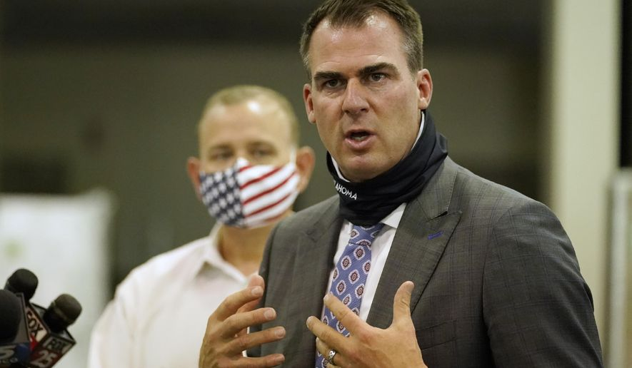 Oklahoma Gov. Kevin Stitt answers a question during a news conference at the Central Oklahoma PPE distribution warehouse Tuesday, Aug. 18, 2020, in Oklahoma City. (AP Photo/Sue Ogrocki)