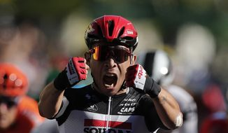 Australia's Caleb Ewan celebrates as he crosses the finish line to win the third stage of the Tour de France cycling race over 198 kilometers (123 miles), with start in Nice and finish in Sisteron, southern France, Monday, Aug. 31, 2020. (Benoit Tessier, Pool via AP)