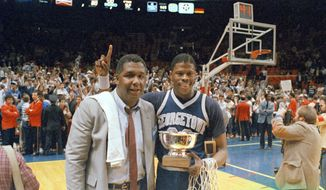 CORRECTS THAT THE GAME WAS AGAINST ST. JOHNS FOR THE BIG EAST CHAMPIONSHIP, NOT AGAINST HOUSTON FOR THE NCAA CHAMPIONSHIP - FILE - In this March 9, 1985, file photo, Georgetown NCAA college basketball head coach John Thompson poses with player Patrick Ewing after Georgetown defeated St. John's in the Big East Championship in New York.  John Thompson, the imposing Hall of Famer who turned Georgetown into a Hoya Paranoia powerhouse and became the first Black coach to lead a team to the NCAA mens basketball championship, has died. He was 78 His death was announced in a family statement Monday., Aug. 31, 2020. No details were disclosed.(AP Photo/File)  **FILE**