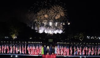 President Donald Trump watches fireworks go off near the Washington Monument after he spoke from the South Lawn of the White House on the fourth day of the Republican National Convention, Thursday, Aug. 27, 2020, in Washington. From left, first lady Melania Trump, Donald Trump, Tiffany Trump, Donald Trump Jr., Kimberly Guilfoyle and Lara Trump. (Doug Mills/The New York Times via AP, Pool)