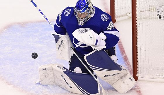 Tampa Bay Lightning goaltender Andrei Vasilevskiy (88) makes a save against the Boston Bruins during first-period NHL Stanley Cup Eastern Conference playoff hockey game action in Toronto, Monday, Aug. 31, 2020. (Frank Gunn/The Canadian Press via AP)