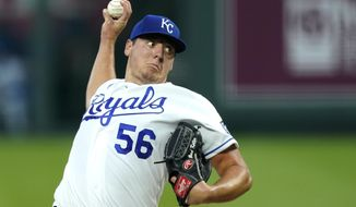 Kansas City Royals starting pitcher Brad Keller throws during the first inning of a baseball game against the Cleveland Indians, Monday, Aug. 31, 2020, in Kansas City, Mo. (AP Photo/Charlie Riedel)