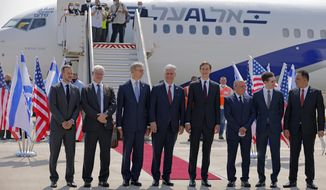 U.S. Presidential Adviser Jared Kushner, center right, and U.S. National Security Adviser Robert O'Brien, center left, pose with members of the Israeli-American delegation in front of the El Al's flight, which will carry the delegation from Tel Aviv to Abu Dhabi, at the Ben Gurion Airport near Tel Aviv Monday, Aug. 31, 2020. (Menahem Kahana/Pool Photo via AP)