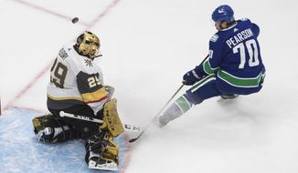 Vegas Golden Knights goalie Marc-Andre Fleury (29) makes a save on Vancouver Canucks' Tanner Pearson (70) during the third period of an NHL Western Conference Stanley Cup playoff game, Sunday, Aug. 30, 2020, in Edmonton, Alberta. (Jason Franson/The Canadian Press via AP)