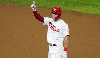 Philadelphia Phillies' Rhys Hoskins reacts after hitting a two-run double off Washington Nationals pitcher Wander Suero during the seventh inning of a baseball game, Monday, Aug. 31, 2020, in Philadelphia. (AP Photo/Matt Slocum)