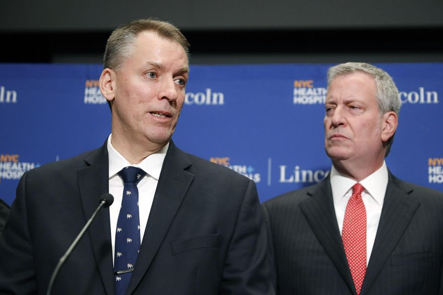 FILE - In this Feb. 9, 2020 file photo, New York City Police Commissioner Dermot Shea, left, speaks alongside Mayor Bill de Blasio during a news conference concerning two police involved shootings, in New York. The nation's largest police department is spelling out potential ramifications for officer misconduct, unveiling on Monday, Aug. 31 a draft of a discipline matrix that will guide punishment decisions similarly to how sentencing guidelines are used in criminal cases. (AP Photo/John Minchillo, File)