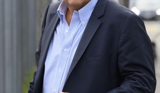 Former UEFA president Michel Platini appears in front of the building of the Office of the Attorney General of Switzerland, in Bern, Switzerland Monday, 31 Aug. 2020. Michel Platini and former FIFA president Sepp Blatter each face interrogation from the Swiss public prosecutor as part of the proceedings opened in 2015 over a payment of 2 million Swiss francs. (Anthony Anex/Keystone via AP)