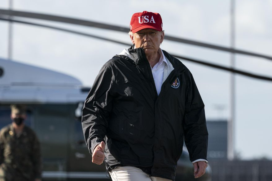 President Donald Trump gives thumbs up while walking to Air Force One upon departure at Chennault International Airport, Saturday, Aug. 29, 2020, in Lake Charles, La. Trump toured damage from Hurricane Laura in Texas and Louisiana. (AP Photo/Alex Brandon)