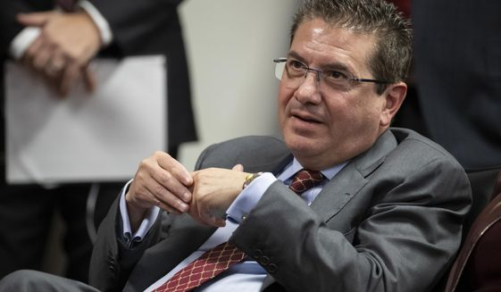 FILE - In this Thursday, Jan. 2, 2020, file photo, Washington Redskins owner Dan Snyder listens to head coach Ron Rivera during a news conference at the team's NFL football training facility, in Ashburn, Va. A person familiar with the situation tells The Associated Press the NFL has taken over the independent investigation into workplace conduct within the Washington Football Team. (AP Photo/Alex Brandon, File)