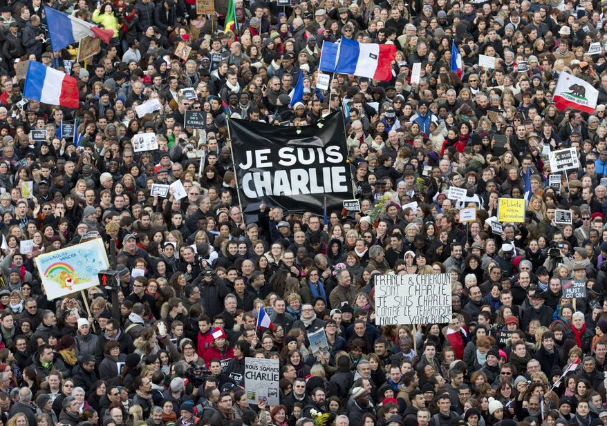 In this Jan. 11, 2015, file photo, thousands of people gather at Republique Square in Paris. The January 2015 attacks against Charlie Hebdo and, two days later, a kosher supermarket, touched off a wave of killings claimed by the Islamic State group across Europe. Seventeen people died along with the three attackers. Thirteen men and a woman accused of providing the attackers with weapons and logistics go on trial on terrorism charges Wednesday, Sept. 2. (AP Photo/Peter Dejong, File)