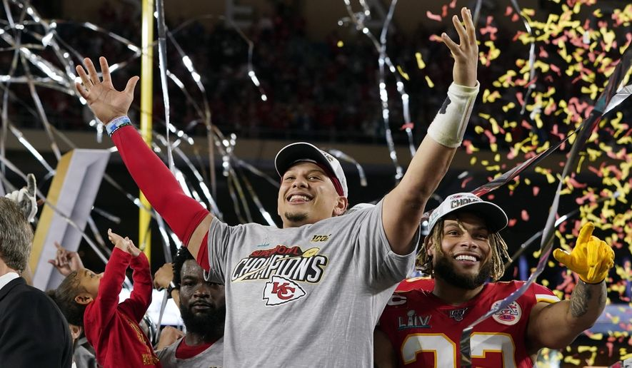 In this Feb. 2, 2020, file photo, Kansas City Chiefs' Patrick Mahomes, left, and Tyrann Mathieu celebrate after defeating the San Francisco 49ers in the NFL Super Bowl 54 football game in Miami Gardens, Fla. Teams could afford recent contracts like the megabucks given to Mahomes and Joey Bosa under normal circumstances. Because of economic effects from the pandemic, future player deals and a salary cap that will be adjusted due to some monetary setbacks, upcoming free agents might find the marketplace tighter. (AP Photo/David J. Phillip, File)