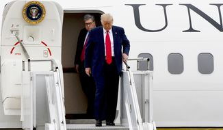 President Donald Trump and Attorney General William Barr, walk from Air Force One as he arrives at Waukegan National Airport before attending a series of events in Kenosha, WI, Tuesday, Sept. 1, 2020, in Waukegan, IL. (AP Photo/Matt Marton)