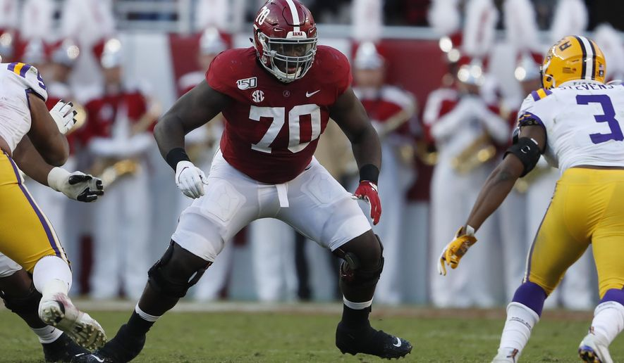 FILE - In this Nov. 10, 2019, file photo, Alabama offensive lineman Alex Leatherwood (70) blocks LSU safety JaCoby Stevens (3) during an NCAA college football game in Tuscaloosa, Ala. Leatherwood was selected to The Associated Press preseason All-America first-team, Tuesday, Aug. 25, 2020.  (AP Photo/John Bazemore, File)