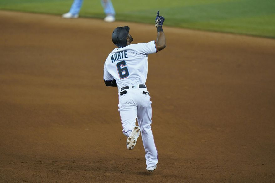 Miami Marlins' Starling Marte celebrates as he rounds first base after hitting a home run during the eighth inning of a baseball game against the Toronto Blue Jays, Tuesday, Sept. 1, 2020, in Miami. (AP Photo/Wilfredo Lee)