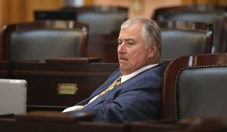 Ex-Ohio House Speaker Larry Householder sits in the House of Representatives in the Ohio Statehouse after returning for the first time since being charged in a $60 million bribery scandal. The morning House session had just ended Tuesday, Sept. 1, 2020 in Columbus, Ohio. [Fred Squillante/Dispatch]/The Columbus Dispatch via AP)