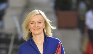 Britain's Secretary of State for International Trade Liz Truss arrives to attend a Cabinet meeting of senior government ministers at the Foreign and Commonwealth Office FCO in London, Tuesday, Sept. 1, 2020. (Toby Melville/Pool via AP)